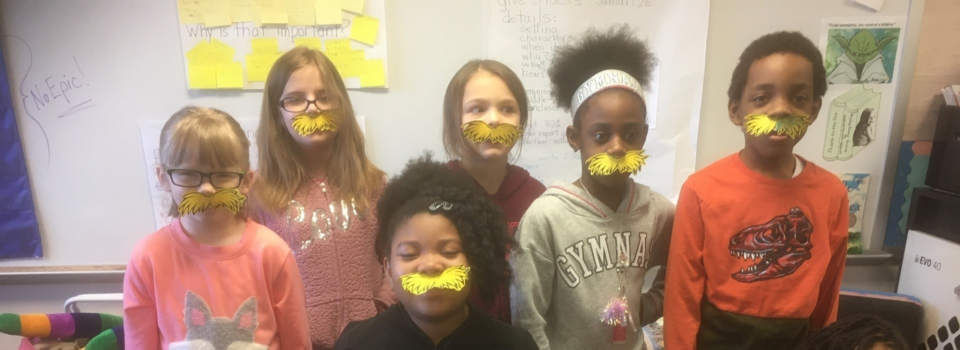 students wearing lorax mustaches